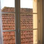 Chambre avec vue sur les toits