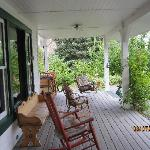 the front porch with swing and rockers