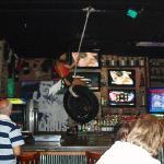 Barmaid swinging on tyre