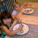 kids enjoying fresh fruit, and waffles..