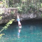 Cliff diving at 1st Cenote jungle oasis