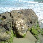 Image of a face carved on rock