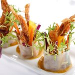 Por Pia Poo Nim, baby soft shell crab rice paper roll with ripe mango, ginger root & Thai herbs