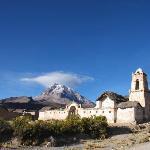 Adobe church and volcano at Tomarapi