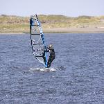 photo of floras lake with windsurfers and kite boarders