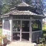 The screened-in gazebo.