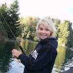 My daughter learning to fish