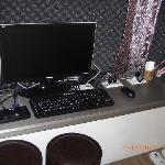An LCD monitor in each room which functions both as PC and TV.