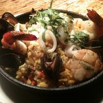 Paella Mariscos - Traditional Spanish saffron rice dish with bell peppers, chorizo, diver scallo
