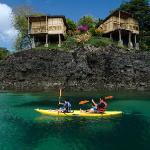 Kayaking in crystal clear water to private beaches