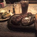 The New York Strip with garlic bread and a baked potato with LOADS of fixins as you can see  :)