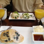 Delicious blueberry pancakes and eggs benedict