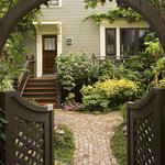 The front entrance to the cottage, takes you under the front building to a beautiful garden.
