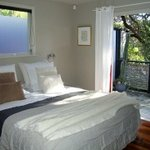 Kauri Suite - King bedroom with french doors