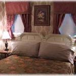 Master bedroom in the Jesse McDonald Suite
