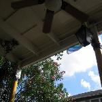 Sitting outside under the balcony.