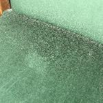 PICTURE OF HAIRS AND DUST ON CHAIR