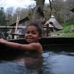 in the hot tub.  celtic round house behind