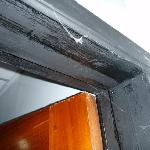 Dust webs on door frame