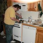 My hubby in the kitchen.