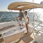A couple enjoying a sail on the harbor