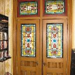 Stain glass doors that lead to a private terrace