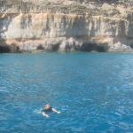 mum swimming in the sea next to the caves