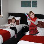 The girls enjoying their room after just arriving from the airport
