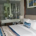 King bed and glass bathroom wall in room 1201