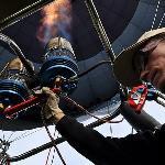 Pilot Lenny heating the balloon.