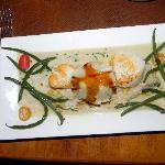 Seared local scallops with corn risotto, mushroom ravioli and corn jus