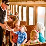 Passengers on the Grapevine Vintage Railroad ride in authentic 1920s Victorian-style coaches.