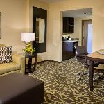 Every guest suite features a separate living room with work area and wet bar