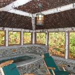 exterior screened in porch with heated jacuzzi tub for Chalet Cottage