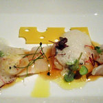 Mediterranean scorpion fish sashimi, ponzu sauce, ginger chutney, wasabi air, garden cress
