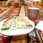 A spinach and cheese gozlemeler and an ayran