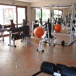 nice fitness room with pool and sauna