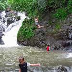 Jumping off the rocks into the pool below!