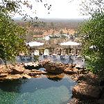 Swimming pool with waterhole in background