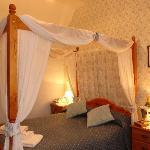 Our cosy Four Poster double en suite room.