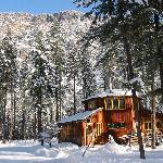 wintery octagonal cabin in the sunshine