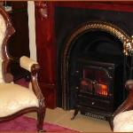 Elegant Victorian fireplaces in each suite