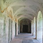 vaulted corridor with frescoes