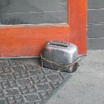 Nonfunctioning toaster used as doorstop, which is kind of hilarious