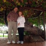 My wife and I under a grape vine planted in 1861