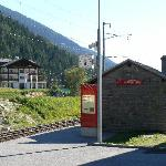 Obergesteln station with hotel behind.