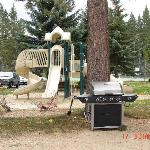 BBQ grills and kids playground at the resort