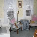 area near bed with chairs