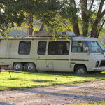 abandoned RV been there so long tires sunk into dirt