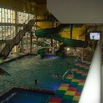 indoor pool area with 2 slides